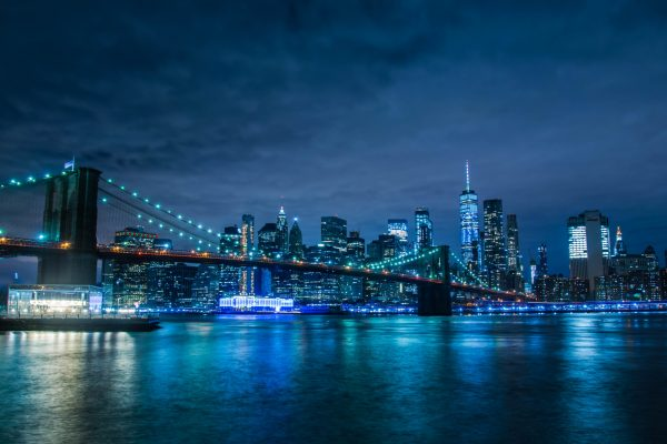 city-skyline-across-body-of-water-during-night-time-3586966